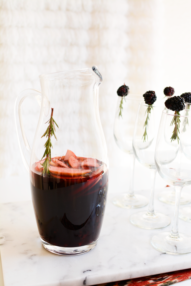 red wine sangria wine glasses with blackberry garnish