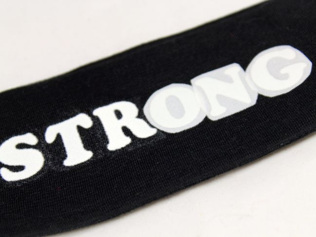 strong black headband white letters