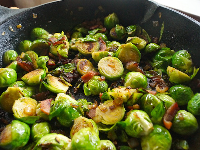 brussels sprouts-bacon bits-black skillet