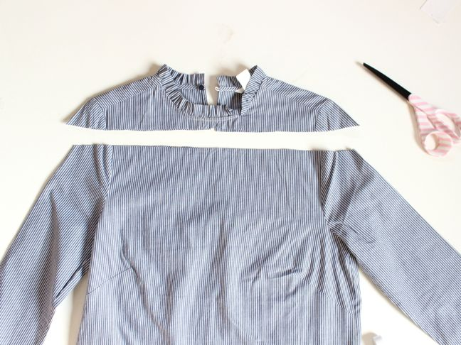 cut-blue-and-white-striped-shirt-scissors