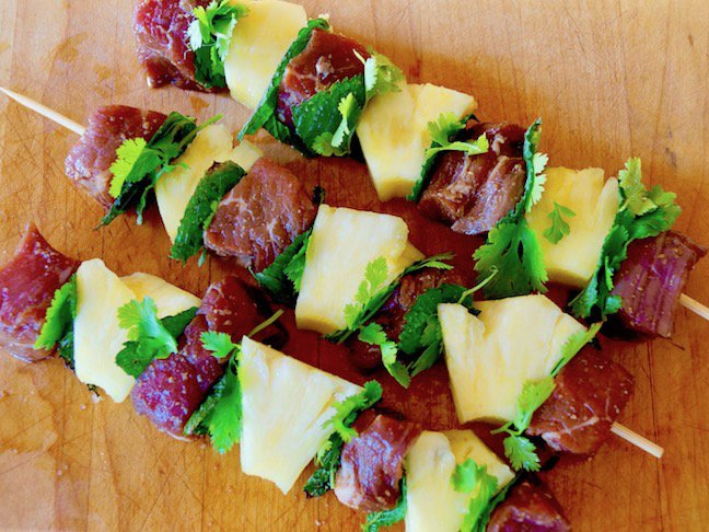 raw meat-steak-pinapple-green herbs