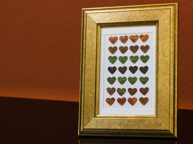 graphic art with hearts in gold frame