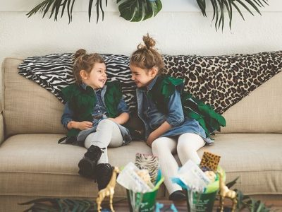 girls-hugging-with-leaf-vests-safari-blankets-jungle-party