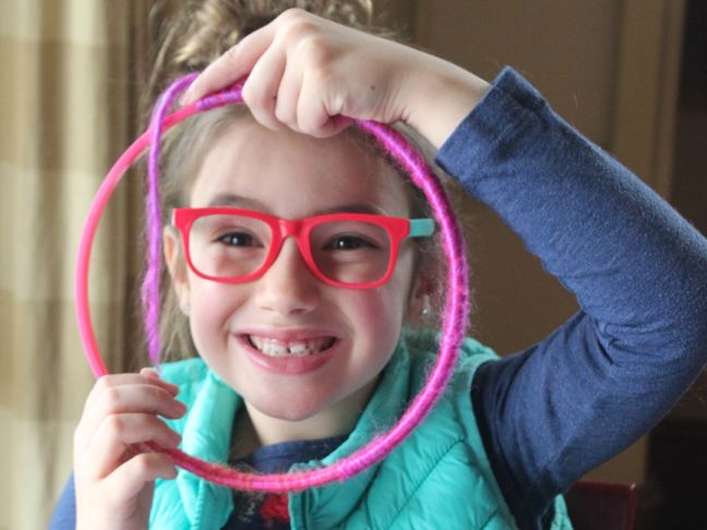 girl-with-glasses-and-embroidery-hoop-with-yarn