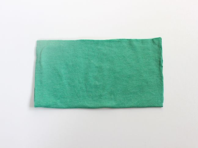 green-tee-folded-in-half