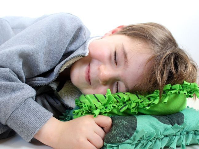 boy-sleeping-on-diy-green-pillows