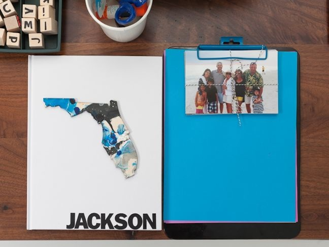 scrapbooking-station-for-kids-marbled-florida-jackson-blue-paper-on-a-clipboard