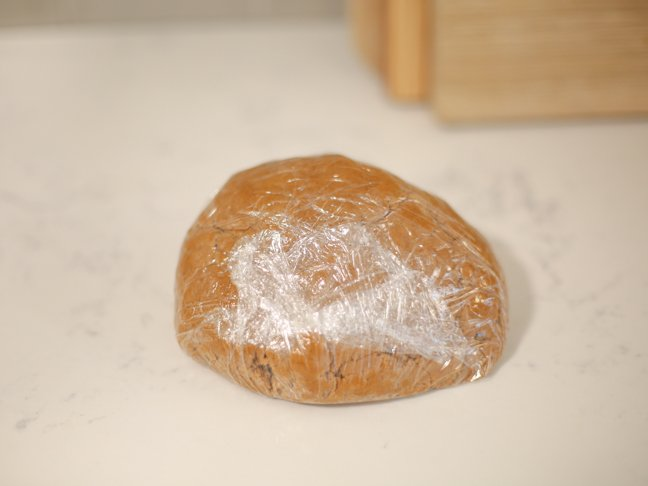 Wrapped and resting gingerbread dough