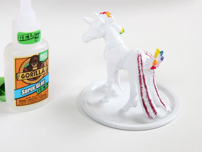 white-toy-unicorn-with-rainbow-color-highlights-glued-to-a-mason-jar-lid-gorilla-glue