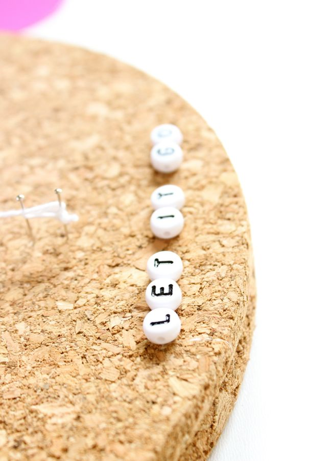 let-it-go-black-and-white-beads-on-cork-material