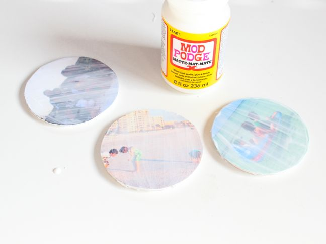 mod-podge-drying-on-round-photos