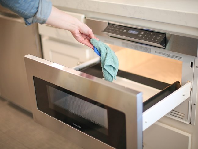 placing-cloth-into-microwave