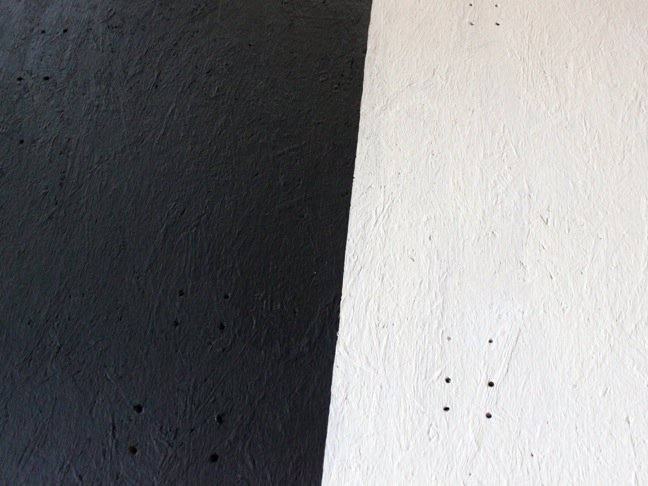 black-and-white-wood-with-small-holes