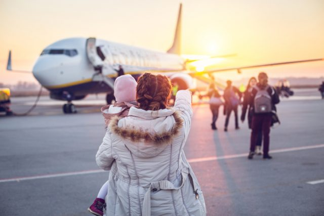 How to Survive Flying During the Holidays with Your Family